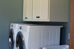 White Painted Laundry Room Cabinets