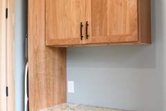 Cherry Laundry Room Cabinetry
